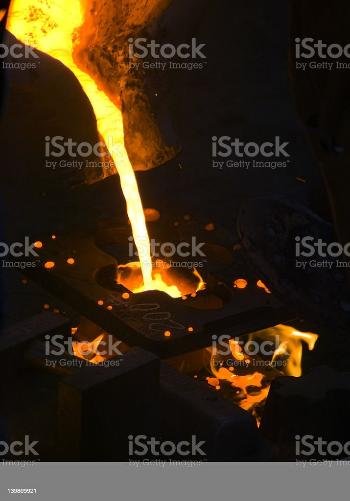 Molten Metal Flowing into Mold royalty-free stock photo