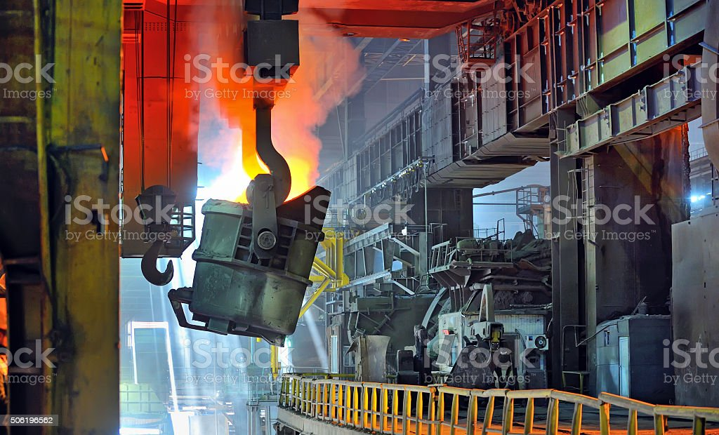 molten metal in ladle stock photo