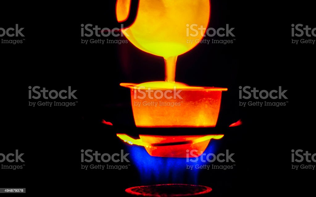 Molten metal poured from lathe for casting stock photo