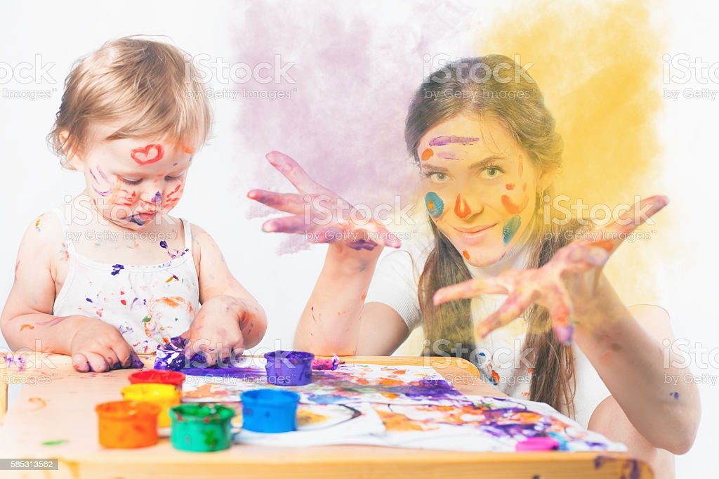 Mom and baby draws with colored inks stock photo