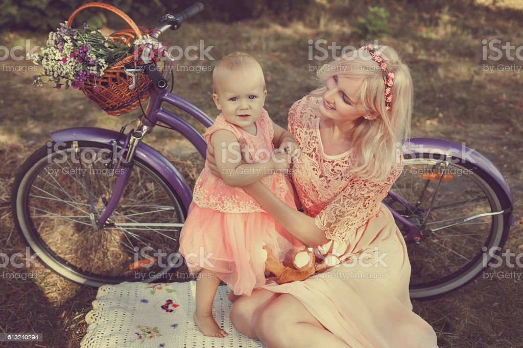 Mom and baby in a pink dress. stock photo