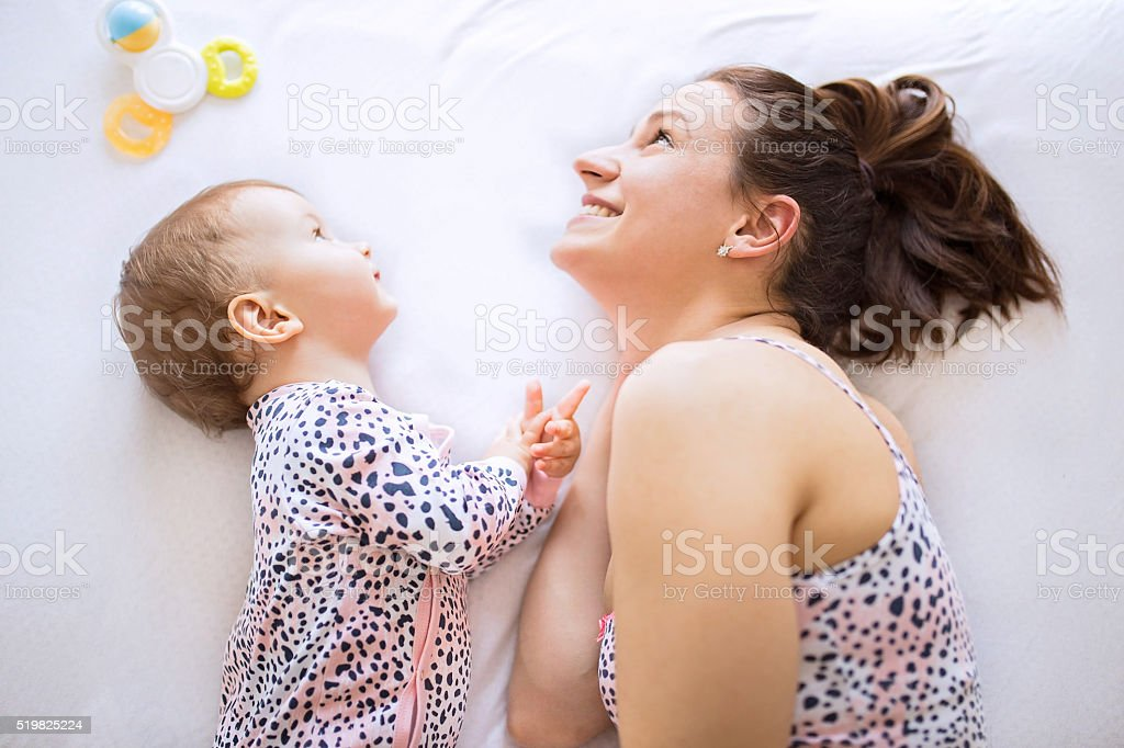 Mom and baby  in bedroom stock photo