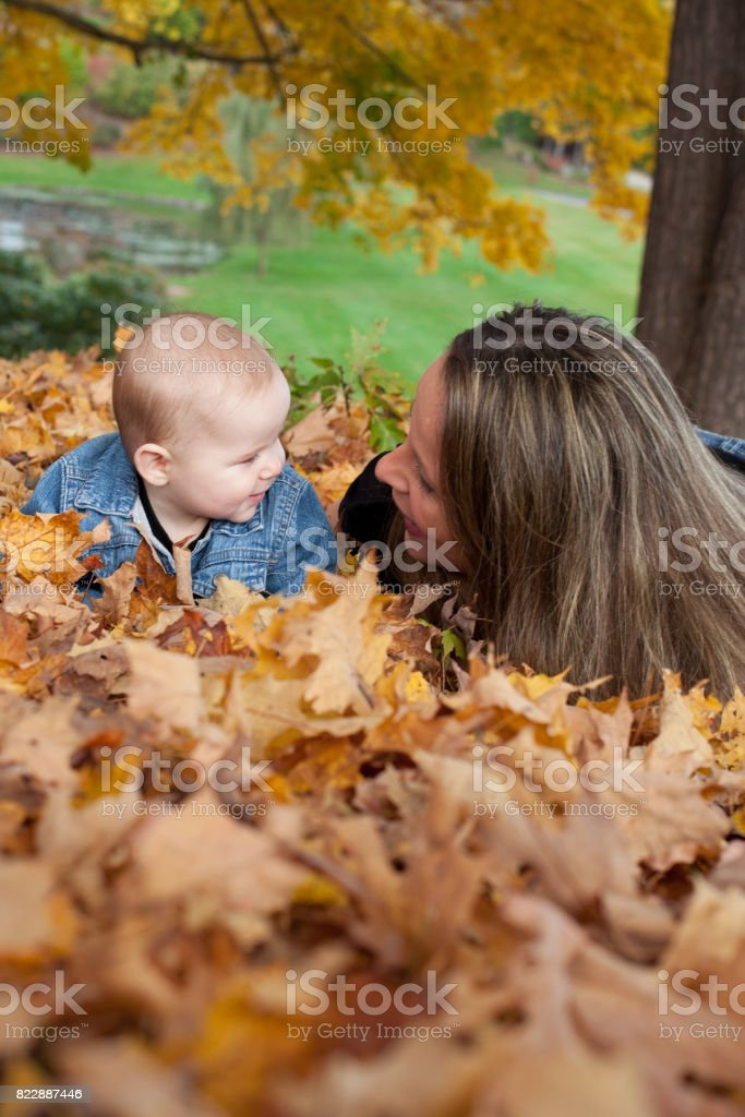 mom and baby talking stock photo