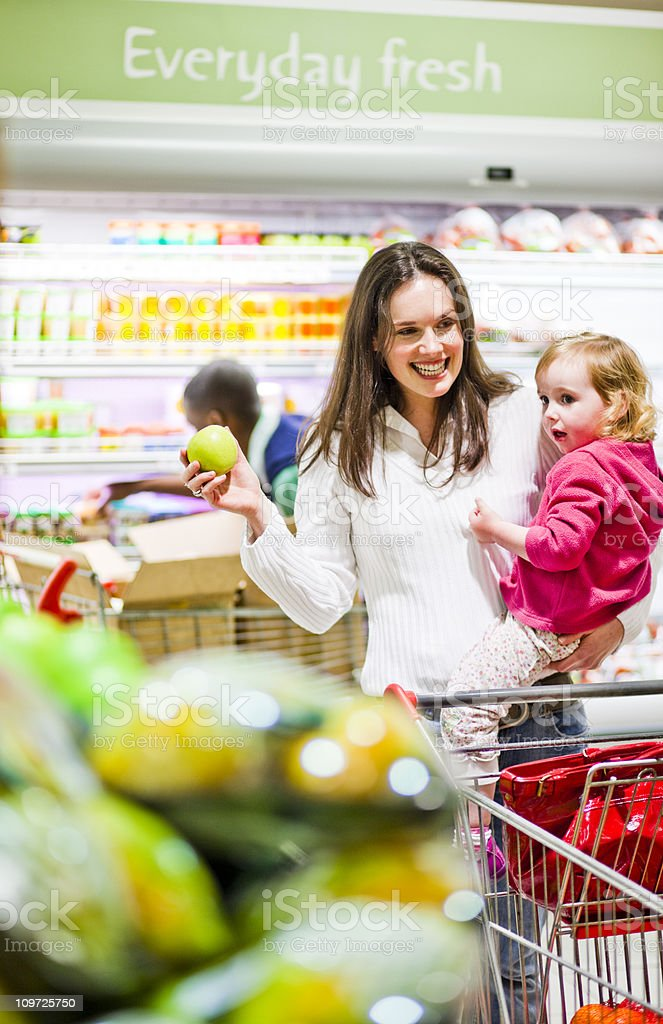 Mom and child at the supermarket royalty-free stock photo