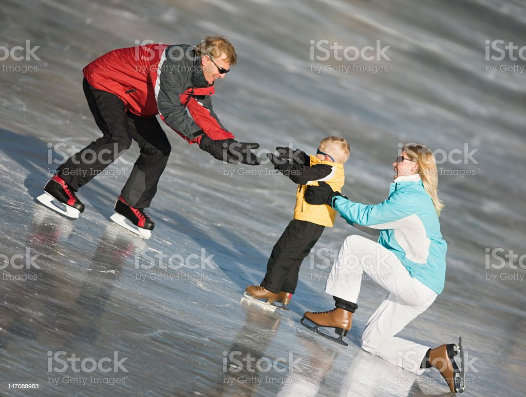 Mom and Dad Teaching Son To Ice Skate royalty-free stock photo