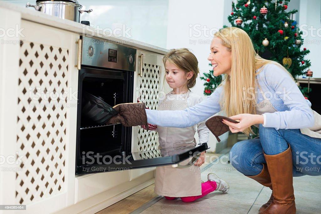 Mom and daughter are preparing  cake for Christmas - Kugelhupf stock photo