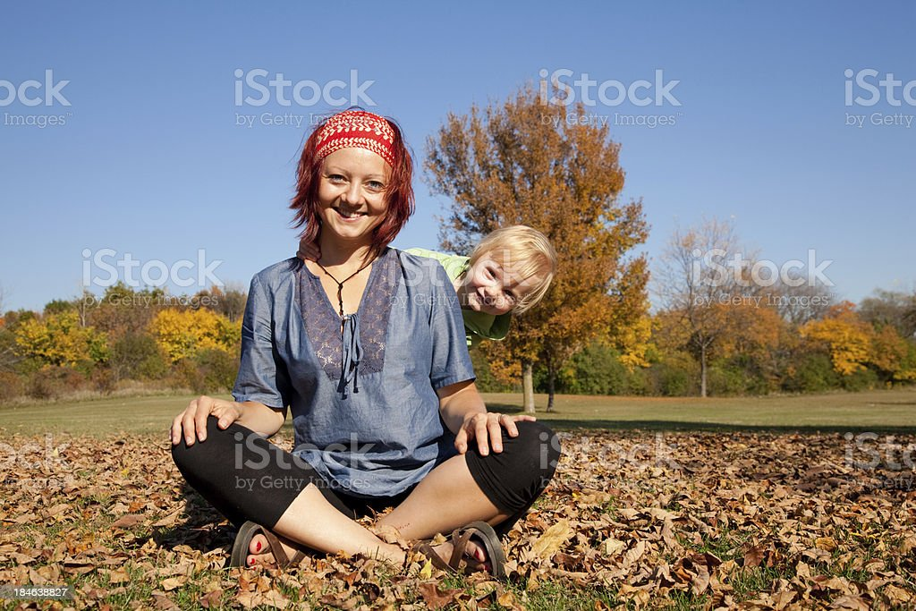 Mom and daughter - autumn / fall scenery stock photo