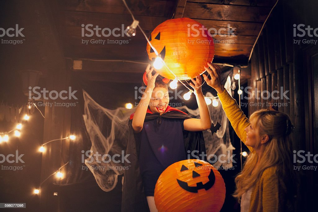 Mom and daughter decorate for Halloween stock photo