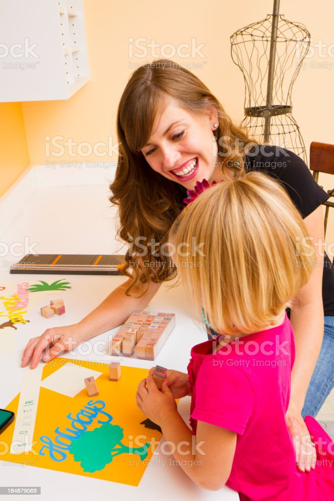 Mom And daughter Enjoying Crafts stock photo