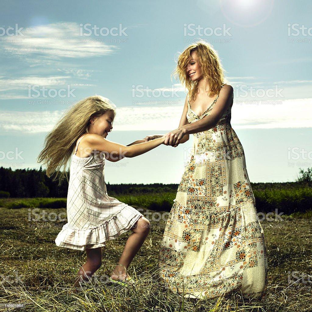 Mom and daughter having fun royalty-free stock photo