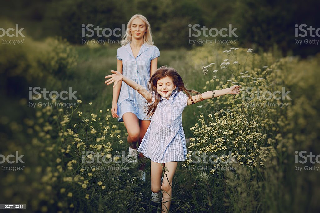 mom and daughter outside stock photo