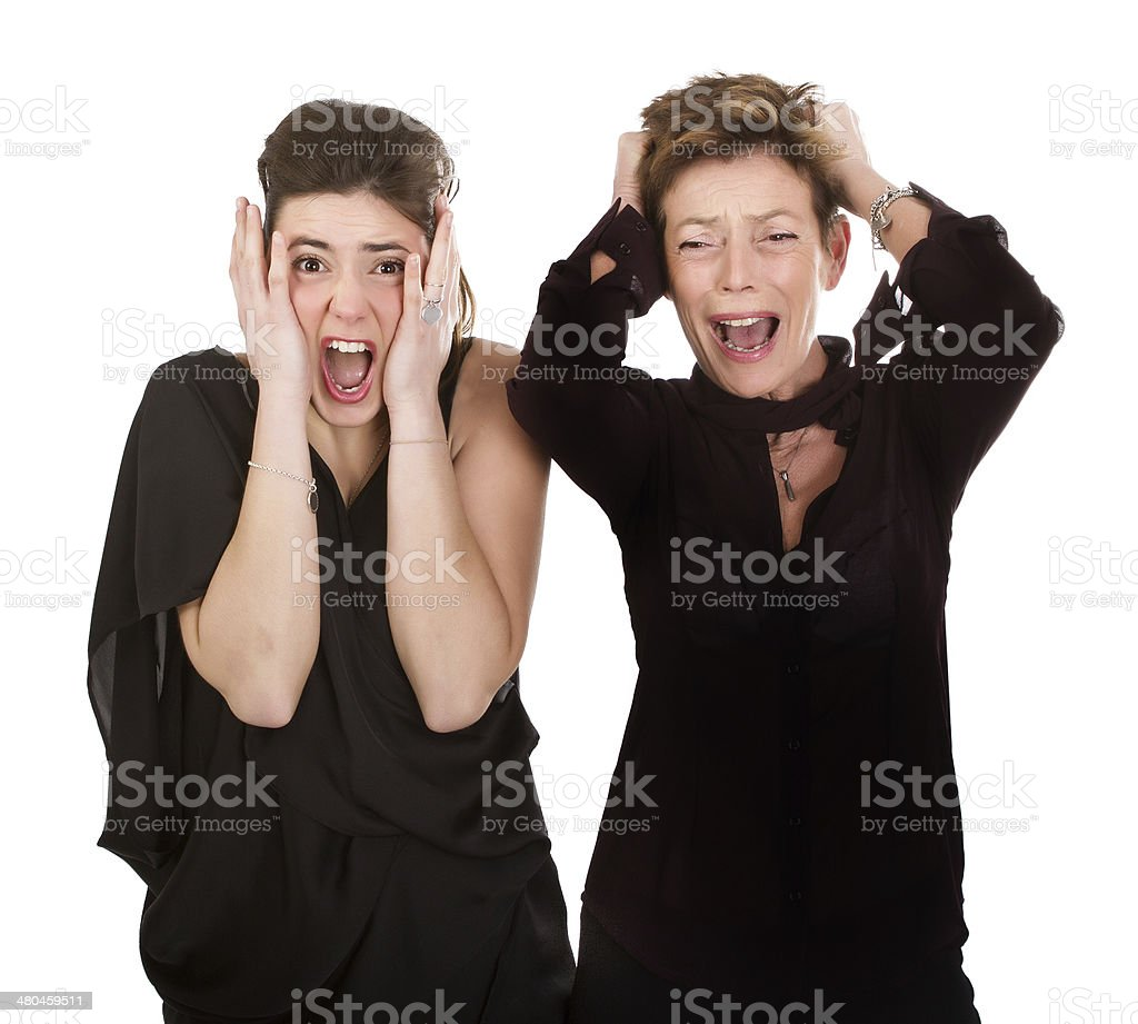mom and daughter screaming in white background royalty-free stock photo