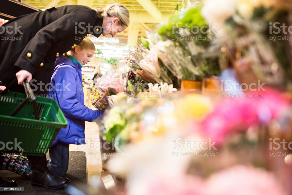 Mom and Daughter Shop for Flowers stock photo