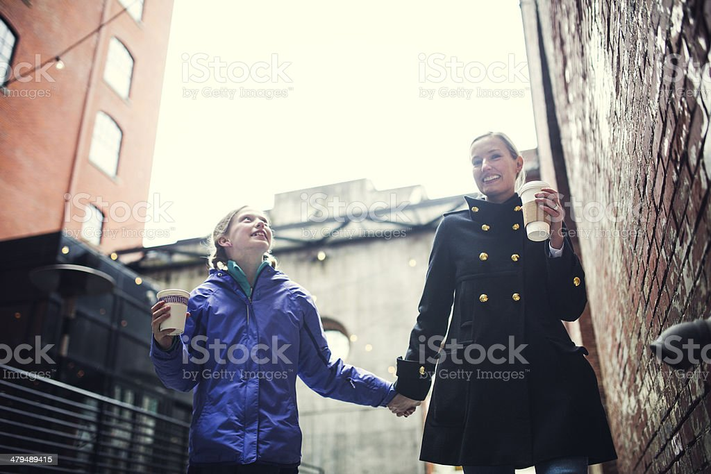 Mom and Daughter Walking with Coffee royalty-free stock photo