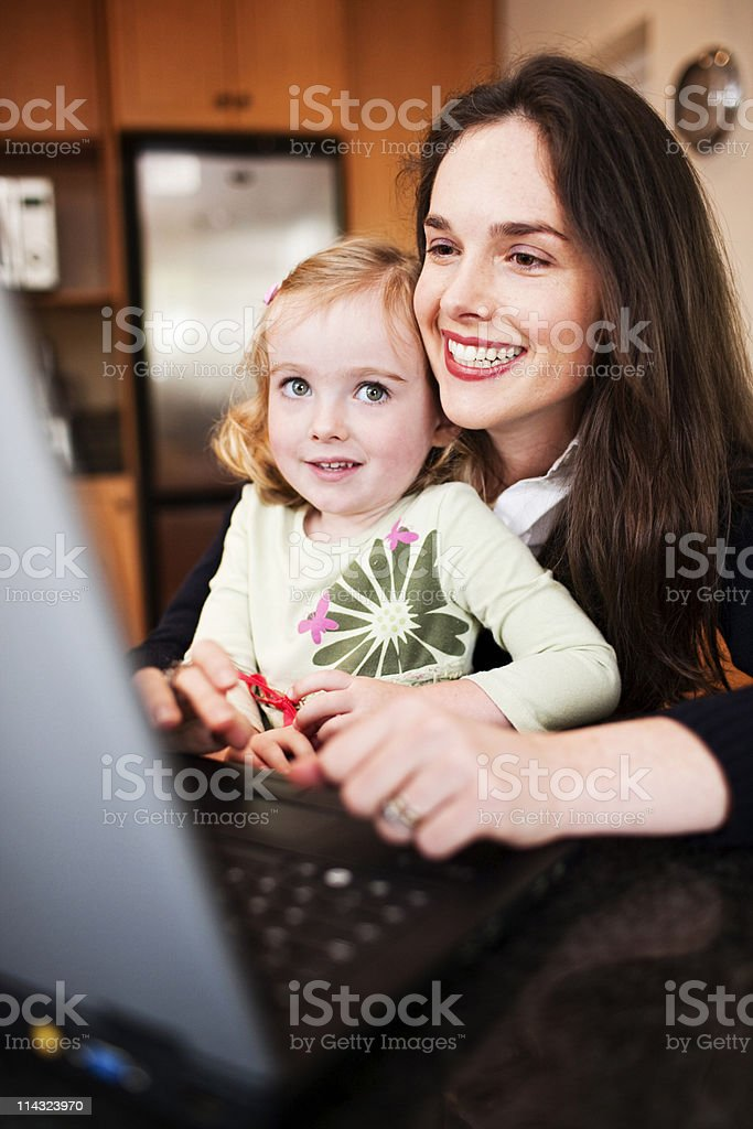 Mom and daughter with laptop computer royalty-free stock photo