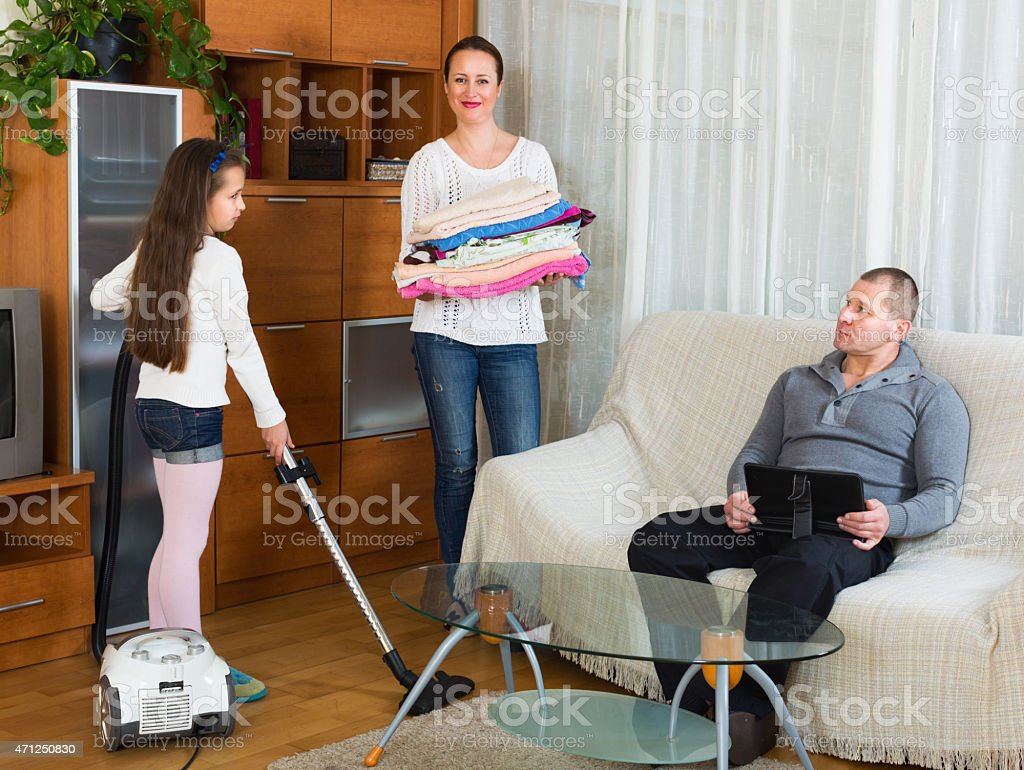 Mom and girl doing cleaning stock photo