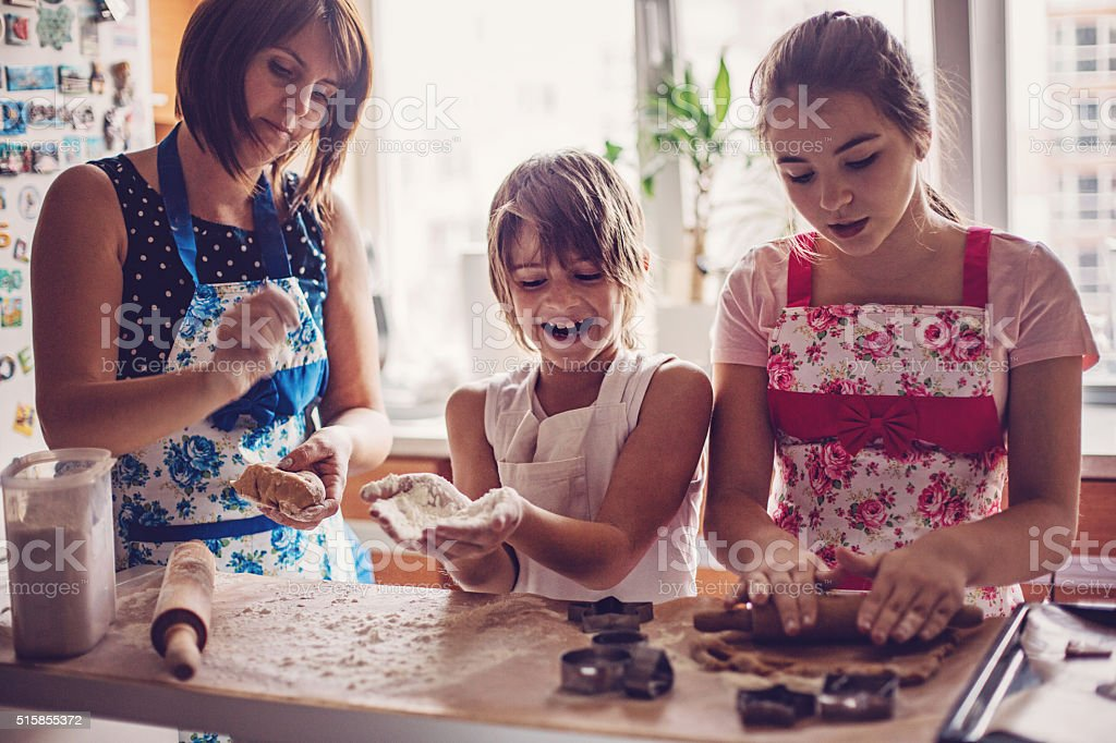Mom and kids cooking stock photo