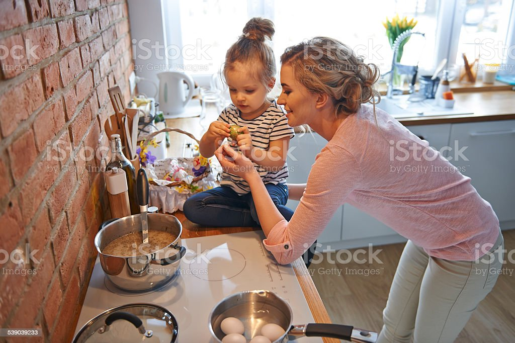 Mom and little daughter preparing for Easter season stock photo