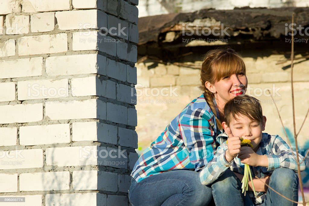 Mom and son in an abandoned building stock photo