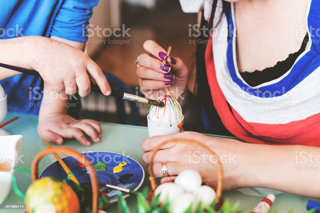 Mom and Son Painting eggs for Easter holiday celebration stock photo