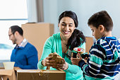 Mom and son prepare box to be moved