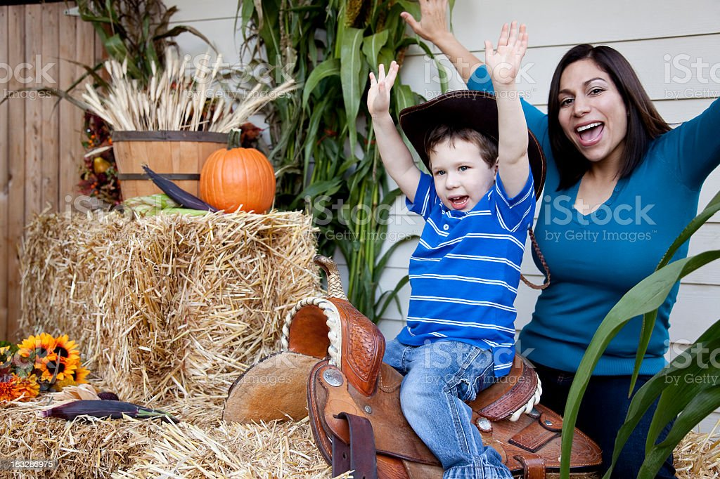 Mom and Son Pretending Together in Autumn Scene royalty-free stock photo
