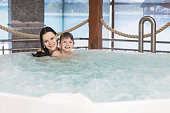 Mom and son relax in the tub