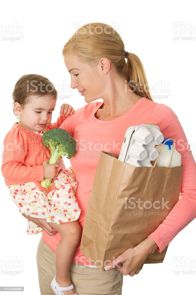 Mom and toddler holding grocery bag and items royalty-free stock photo