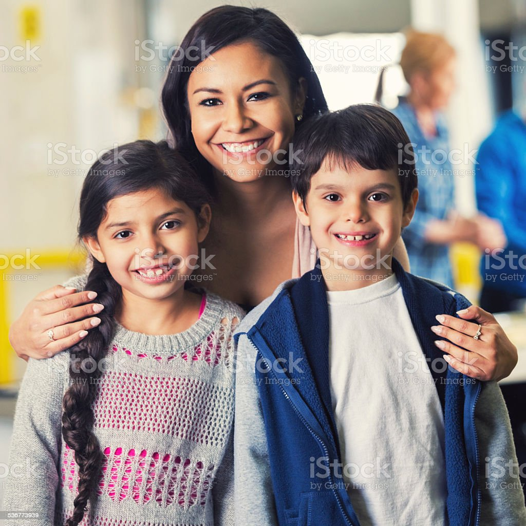 Mom and young children at local food bank stock photo