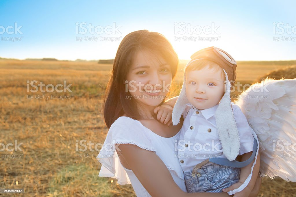 Mom and young son playing in the field. stock photo