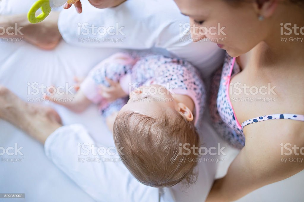 Mom babysiting for her baby stock photo