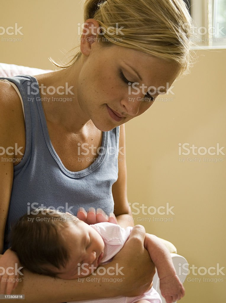 Mom burping baby stock photo