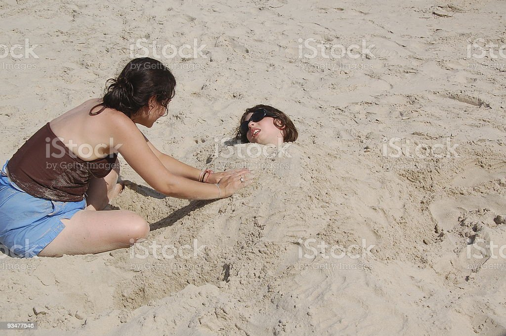 Mom burying her Son stock photo