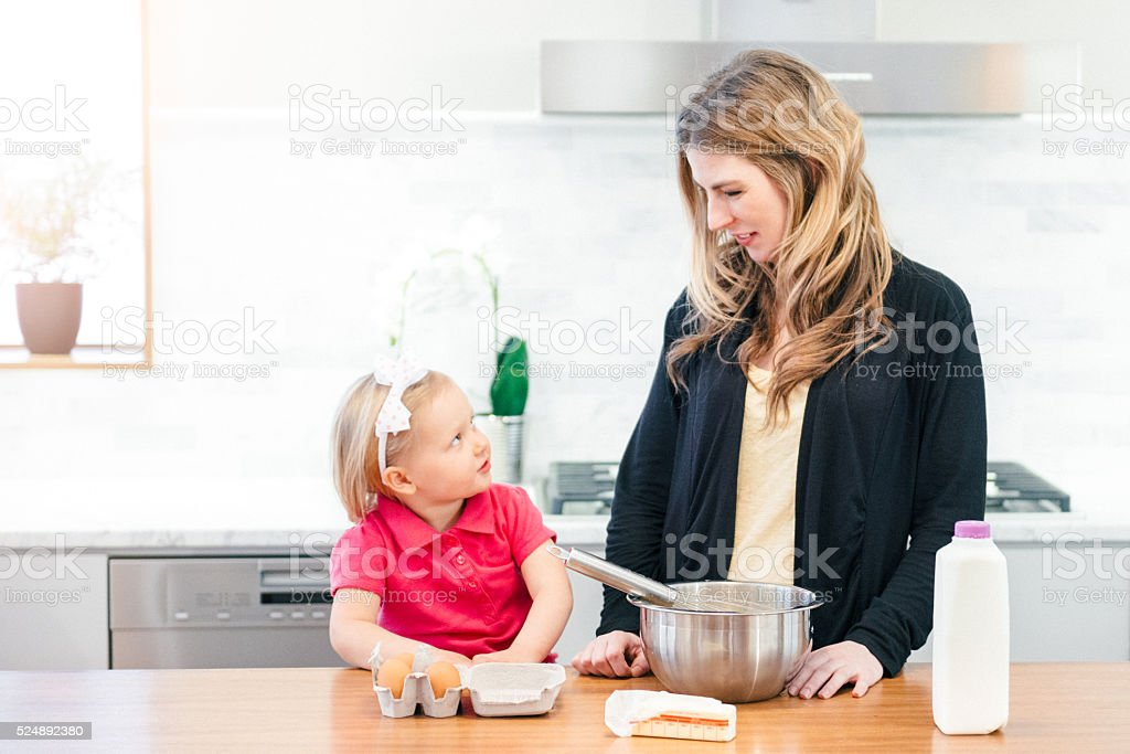 Mom can I help you cook? stock photo