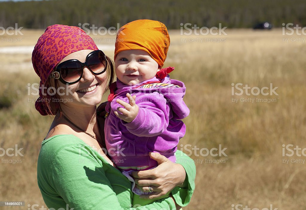 Mom carrying baby daughter in Yellowstone National Park stock photo