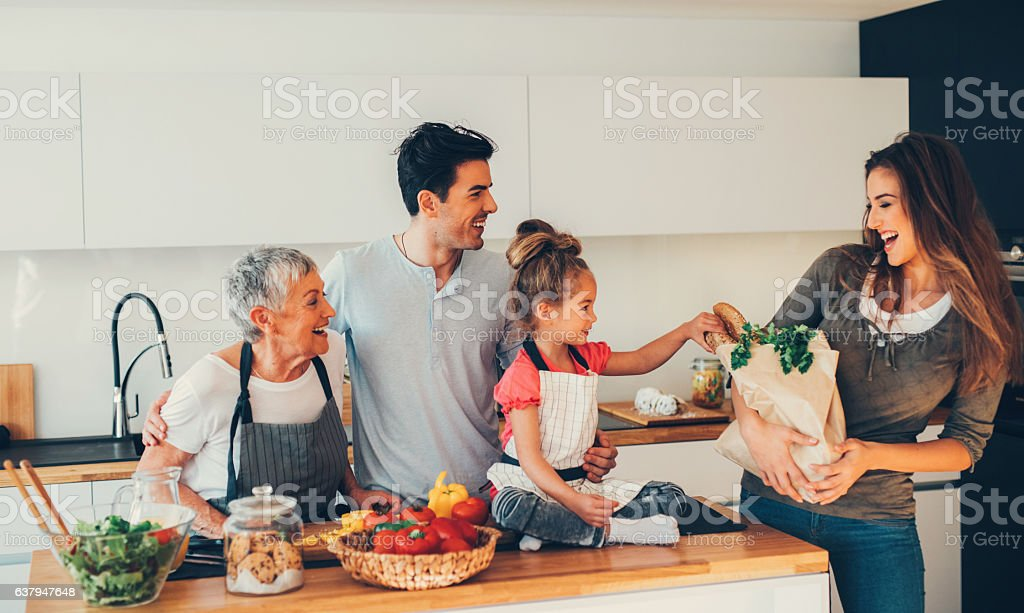 Mom coming home from shopping stock photo