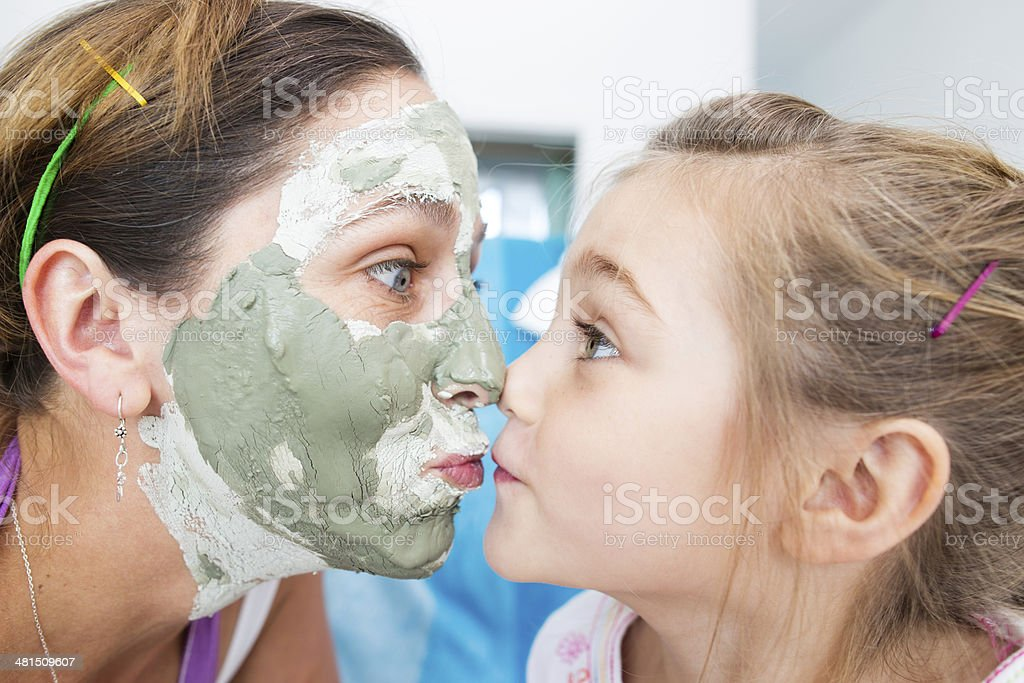 Mom & Daughter nose to nose stock photo