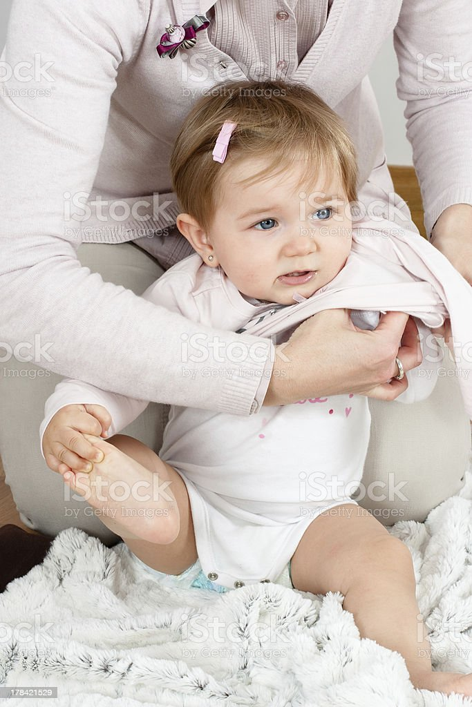 Mom dressing up baby royalty-free stock photo