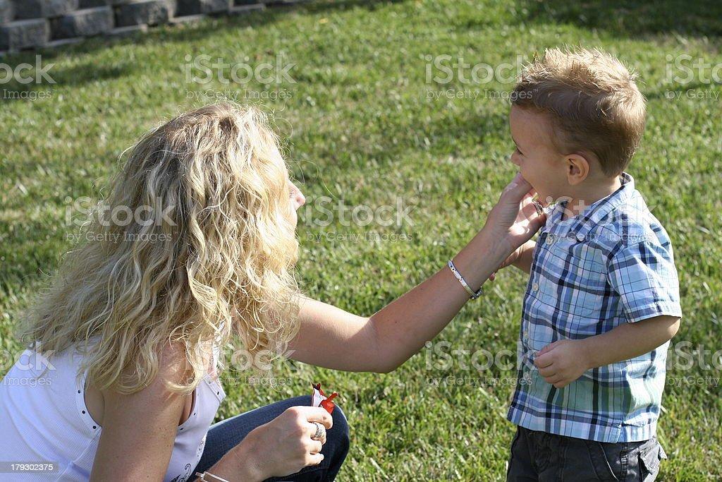 Mom feeding son royalty-free stock photo