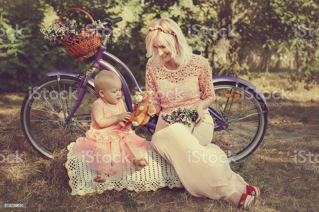 Mom gives a child toy. stock photo