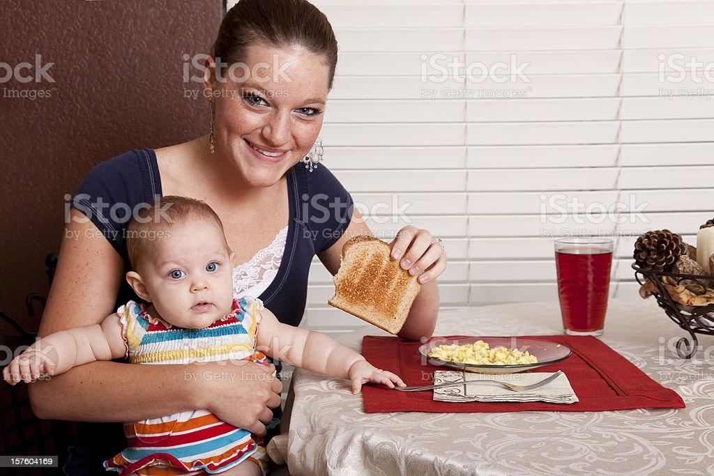 Mom Having Breakfast with Baby royalty-free stock photo