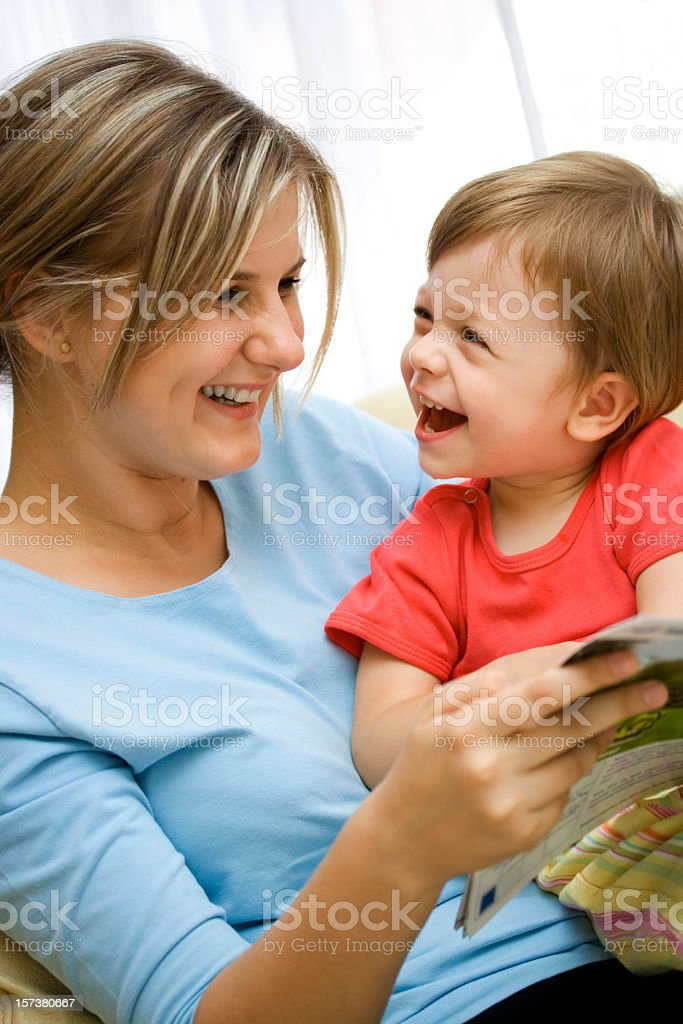 Mom having story time with her young son royalty-free stock photo