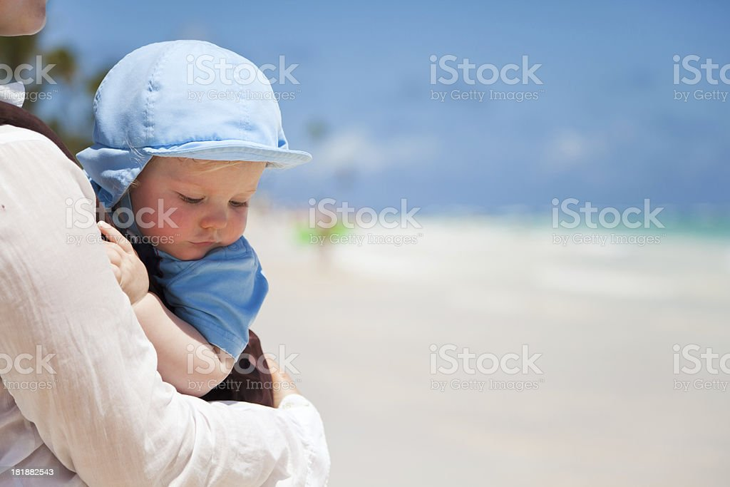 Mom holding her baby boy son royalty-free stock photo