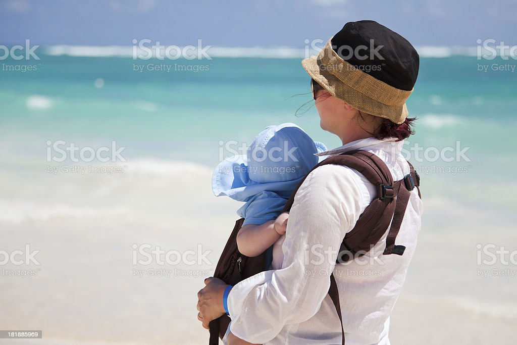 Mom holding her baby boy son stock photo