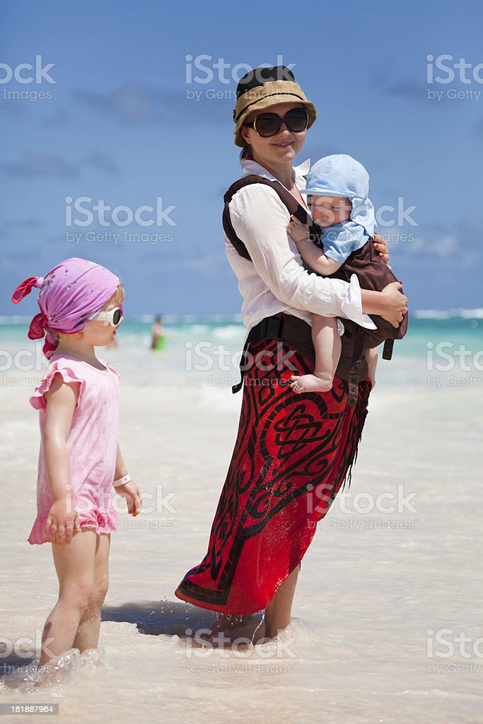 Mom holding her son standing with daughter royalty-free stock photo
