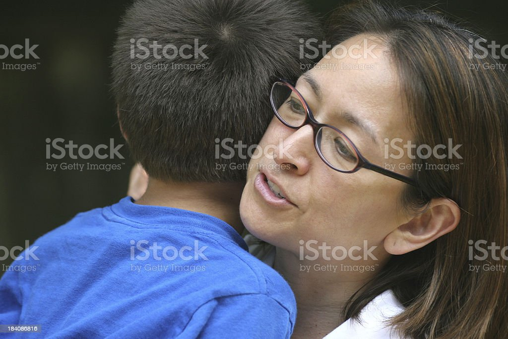 Mom holding son stock photo