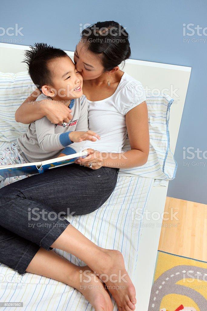 Mom kisses her son. stock photo