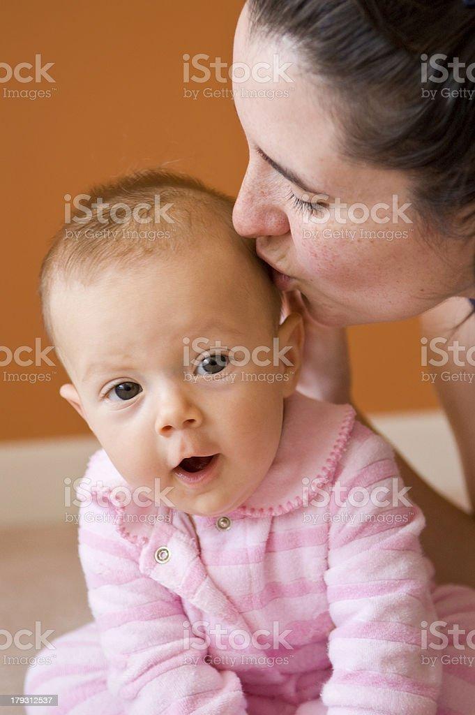 Mom Kissing Baby Girl royalty-free stock photo