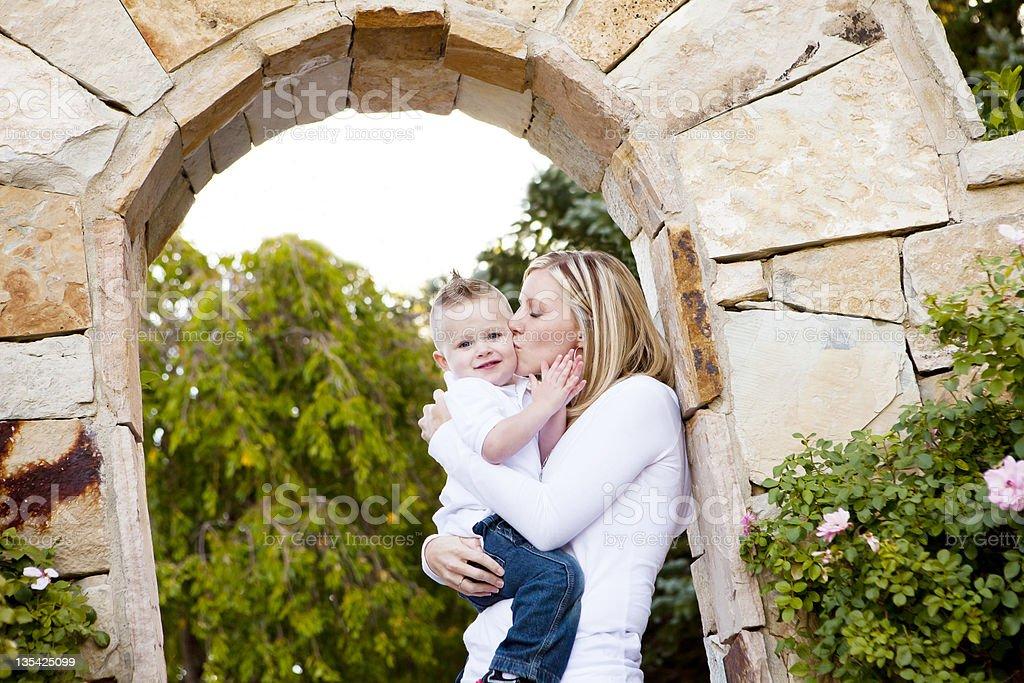 Mom Kissing Son stock photo