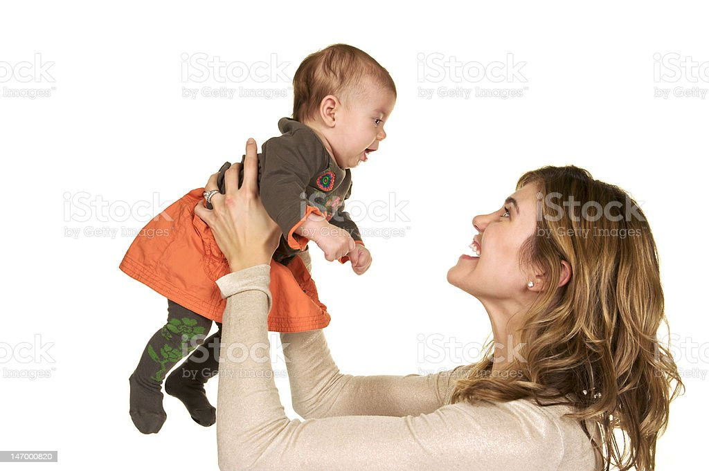 Mom lifting baby girl above her head with big smile royalty-free stock photo
